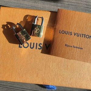Louis Vuitton Lock Me earrings.